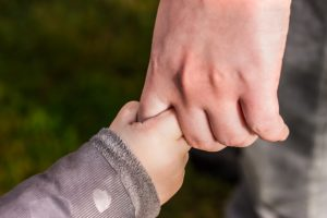 Parent and Child. Child Holding finger of an adult