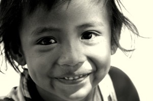 Smiling boy child face black and white