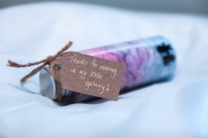 Gratitude. A Brown Thank You Card on Pink and Blue Small Bottle